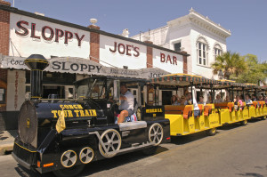 Visitors in Key West, Fla., ride the Conch Tour Train as it passes in front of Sloppy Joe's Bar, former watering hole of author Ernest Hemingway. The faux train and Old Town Trolley are two of the island's primary motorized tour operations. Key West is the southernmost city in the continental United States.  Photo by Bob Krist/Florida Keys News Bureau